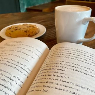 A #RainyDay spent with a cookie, a brown sugar vanilla latte, and a good book is a rainy day spent well 😌 What are y'all up to today?  (And yes, the cookie is made with @viderichocolate and the latte has @carrborocoffee espresso! #SupportLocal)